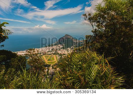 Beautiful Landscape With City And Mountain Views In Sunny Weather With Corcovado Mountain. Rio De Ja