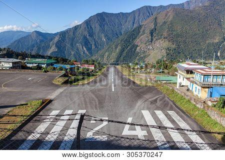 Lukla/nepal - October 18, 2015: Tenzing-hillary Airport Behind A Fence In Lukla, Himalayas, Nepal.