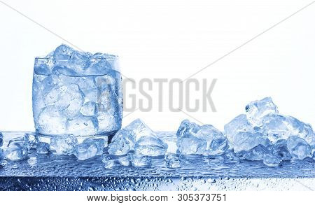 Water With Crushed Ice Cubes In Glass Isolated On White Background