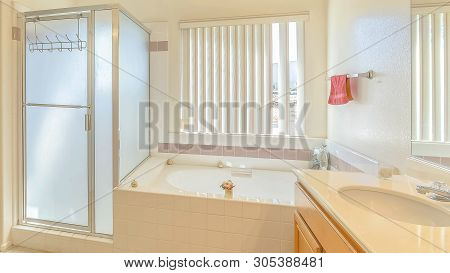 Panorama Interior Of A Bathroom With Built In Bathtub Vanity Area And Separate Shower