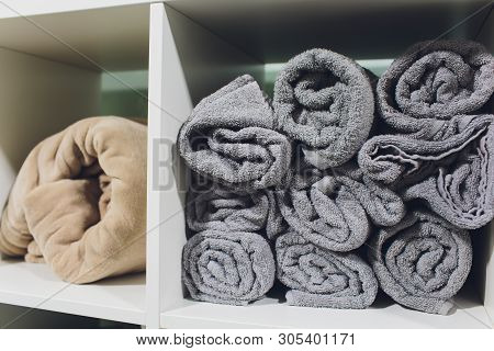 Stack Of Colorful Brown And White Towels On The Table In The Bathroom Spa.