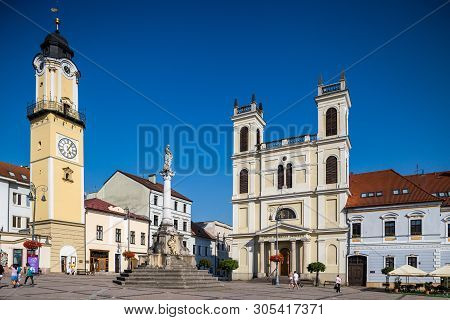 Banska Bystrica, Slovakia - August 07, 2015: Old Main Square, Clock Tower And St. Francis Xavier Cat