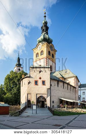Banska Bystrica, Slovakia - August 06, 2015: Old Castle With Clock Tower On Sunny Day. Barbican.