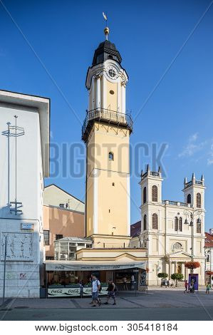 Banska Bystrica, Slovakia - August 06, 2015: Clock Tower With St. Francis Xavier Church In Banska By