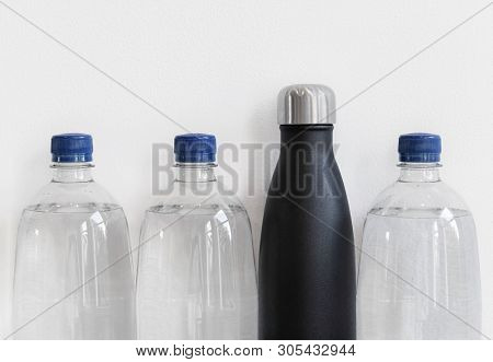 Plastic Bottles And Reusable Bottle Made From Stainless Steel. Plastic Alternative Concept, With Cop