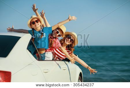 Happy  Family Mother And Children Girls Goes To Summer Travel Trip In The Car