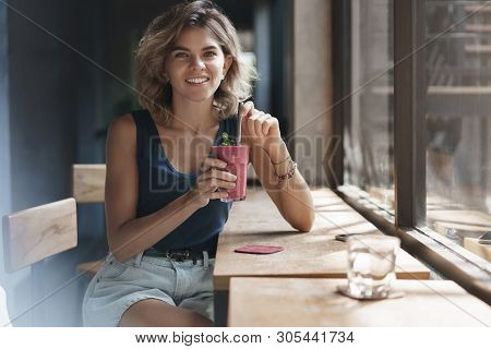 Attractive Sociable Friendly-looking Alluring Blond Woman Short Hairstyle Drink Tasty Smoothie Lean