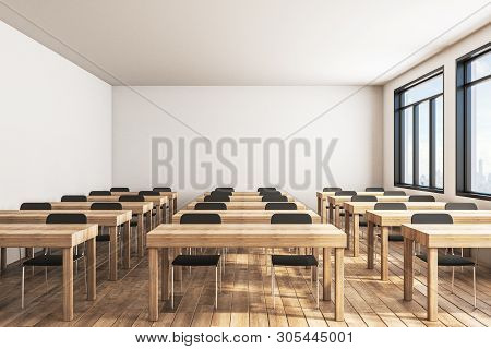 Contemporary Wooden Classroom Interior With Desks, Chairs And Bright City View. Education And Knowle