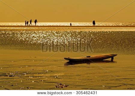 Surfboard On The Beach At Golden Hour Sunset. Sankt Peter-ording In Northern Germany