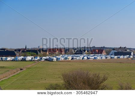 Sankt Peter-ording, Germany - April 19, 2019: A Lot Of Camping Trailers Parking In Famous Holiday Re