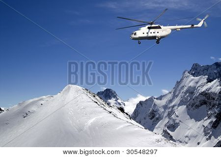 Helicopter in snowy mountains. The winter sunny day poster