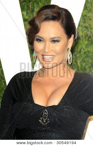 LOS ANGELES - FEB 26:  Tia Carrere arrives at the 2012 Vanity Fair Oscar Party  at the Sunset Tower on February 26, 2012 in West Hollywood, CA