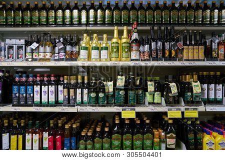 ZURICH, SWITZERLAND - CIRCA OCTOBER, 2018: bottles of wines on display at Coop grocery store in Zurich.