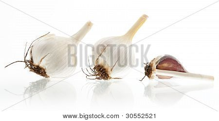 Three Garlic Bulbs On White