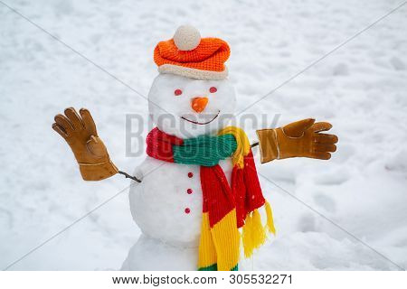 Happy Funny Snowman In The Snow. Christmas Background With Snowman. Winter Background With Snowflake