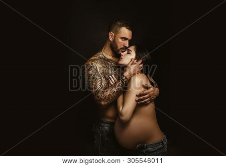 Couple In Love Pregnant Cuddling, Waiting For Baby. Real Romantic Passionate Moment. Bearded Man Wit