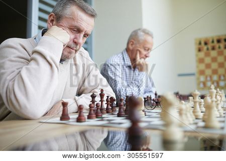 Two Experienced Aged Chess Players With Silver Hair Trying To Solve Difficult Chess Problems