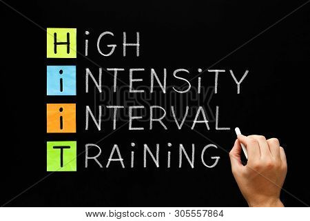 Hand Writing Fitness Workout Acronym Hiit - High Intensity Interval Training With White Chalk On Bla