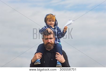 Fathers Day. Father And Son In The Park. Cute Boy With Dad Playing Outdoor. Child Sits On The Should