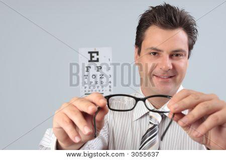 Optometrist Holding Eye Frames
