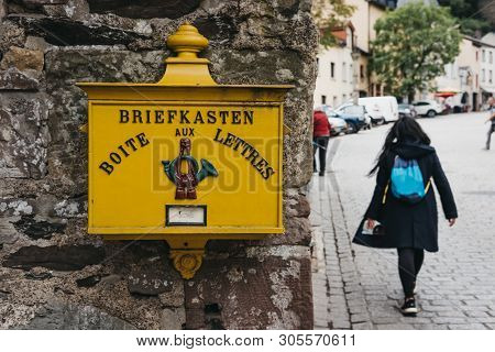Vianden, Luxembourg - May 18, 2019: Yellow Post Box On A Wall In Vianden, Town In Luxembourgs Ardenn