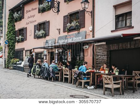 Vianden, Luxembourg - May 18, 2019: People Sitting At The Outdoor Tables Of A Restaurant In Vianden,