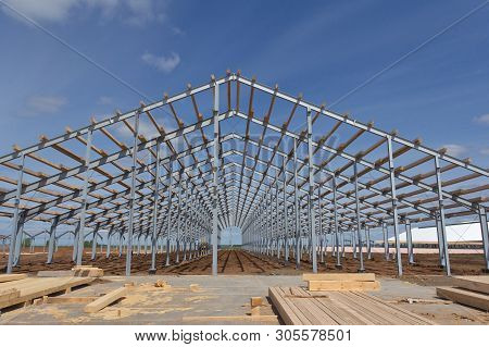 Wooden Beams On Steel Structure For Further Construction. Metal Frame For The Installation Of Insula