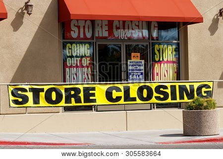 Store Closing And Going Out Of Business Signs Displayed At A Soon To Be Closed Store I