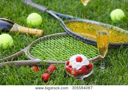Strawberries With Whipped Cream, Glass With Champagne And Tennis Equipment On Wimbledon Tournament G