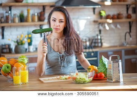 Ready For Revenge. Angered By Deceived Wife Beats A Kitchen Knife On A Wooden Board A Fit Of Passion