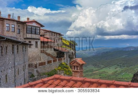 Red Tiled Rooftops Of Stunningly Located On Top Of A Rock Holy Monastery Of Great Meteoron In Meteor