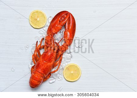 Lobster Food On Ice Seafood Shrimp With Lemon On White Wooden Table Dinner Background On Top View