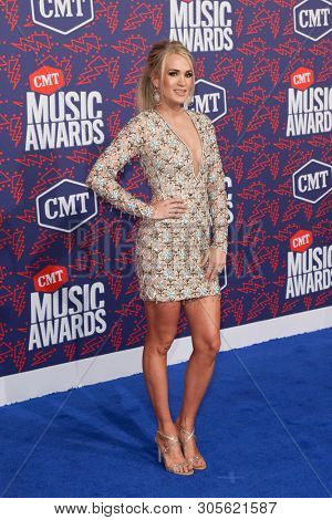 NASHVILLE - JUN 5: Carrie Underwood (L) and Mike Fisher attend the 2019 CMT Music Awards at the Bridgestone Arena on June 5, 2019 in Nashville, Tennessee.