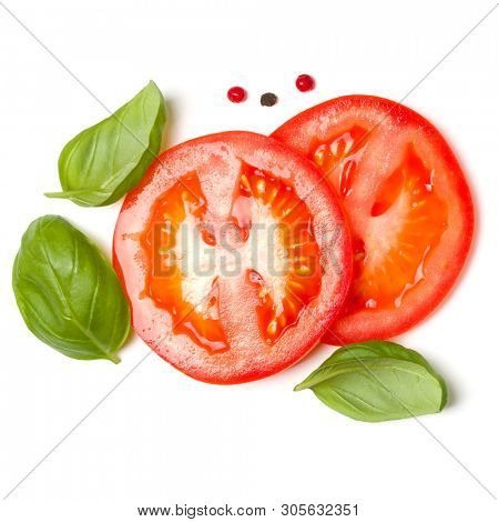 Slices of tomato and basil leaves isolated on white background. Top view, flat lay.