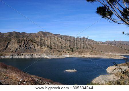 View Across La Concepcion Reservoir Towards The Mountains (embalse Del Limonero), Malaga, Costa Del