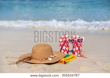 Hat And Flip Flop On White Sandy Tropical Beach, Summer Vacation And Travel Concept
