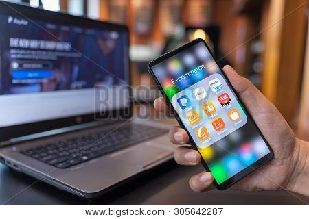 Chiang Mai, Thailand - May.01,2019: Man Holding Xiaomi Mi Mix 3 With Icons Of E-commerce And Online
