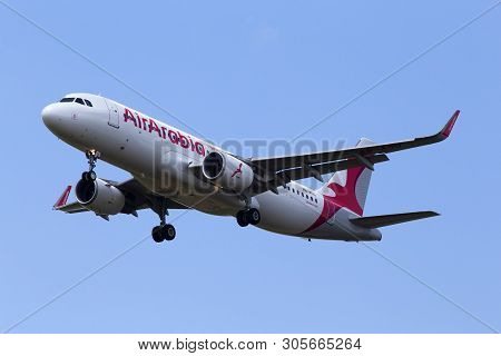 Borispol, Ukraine - June 07, 2019: A6-aou Air Arabia Airbus A320-214(wl) Aircraft On The Blue Sky Ba
