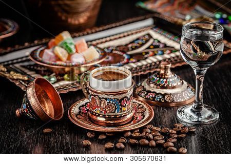 The Concept Of Turkish Cuisine. Turkish Brewed Black Coffee. Beautiful Coffee Serving In The Restaur