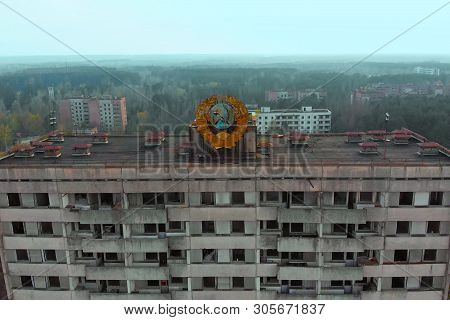Pripyat Aerial Panorama Cityview Over The Sign Of Ussr On The Roof Of Building. Drone Flies Over The