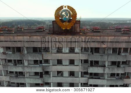 Soviet Coat Of Arms On A High-rise Building In Pripyat, View From Above. Pripyat Aerial Panorama Cit