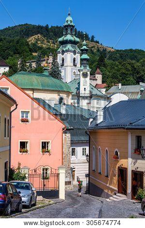 Banska Stiavnica, Slovakia - August 06, 2015: Tourust Walk Along The Narrow Streets Of Banska Stiavn