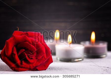 Close Up Of  Red Rose And Burning Candles On Grey Textured Background. Card For Mourning, Death, Sor