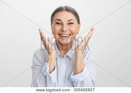 Positive Vibrations And Human Emotions. Pleased Ecstatic Lucky Elderly Caucasian Female In Blue Shir