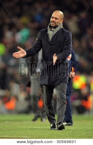 BARCELONA - FEB 19: Josep Guardiola of FC Barcelona shows his disappointment during the Spanish league match against Valencia CFa at the Camp Nou stadium on February 19, 2012 in Barcelona, Spain