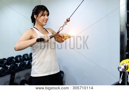 Woman exercise workout in gym fitness.concept of healthy.athlete builder muscles lifestyle.Exercise