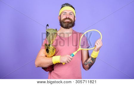 Achieved Top. Tennis Player Win Championship. Athlete Hold Tennis Racket And Golden Goblet. Win Tenn