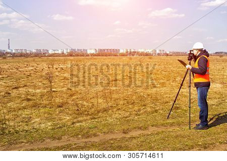 Surveyor Worker Measures The Distance And Length Using Measuring Equipment For The Construction Of A