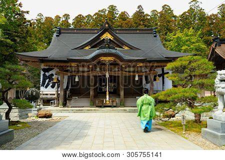 People in Kimono walking in the Kumano Hongu Taisha temple courtyard, Japan