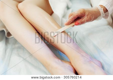 Application Of Contact Gel Before Laser Hair Removal Procedure.